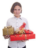 Hands full of presents. Handsome teenage boy with bunch of presents in his hands Stock Photo