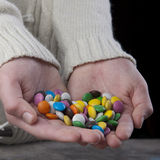 Hands full of sweets. Close up photo Royalty Free Stock Photo