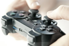 Hands with game controller Stock Images