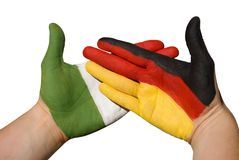 Hands with german and italien flag Stock Images