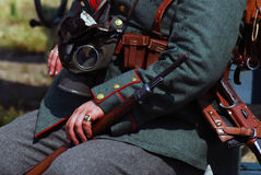 Hands of a German soldier-reenactor Stock Images