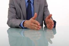 Hands gesturing while speaking. Businessman hands gesturing while speaking Royalty Free Stock Images