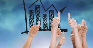 Hands gesturing thumbs up with graph in background Royalty Free Stock Photography