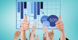 Hands gesturing thumbs up with graph in background. Digital composite of Hands gesturing thumbs up with graph in background Stock Photo
