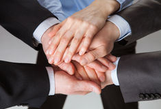 Hands getting together Stock Photos