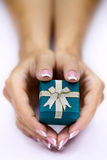 Hands and gift Royalty Free Stock Images