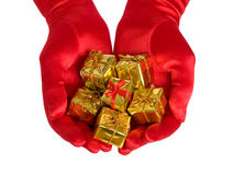 Hands with gifts Royalty Free Stock Image