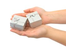 Hands and gifts Stock Photos