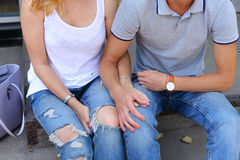 Hands Girl and boy couple sitting on the porch of the restaurant Royalty Free Stock Photography