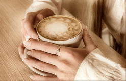 Hands of  girl keeps cup  coffee Stock Photos