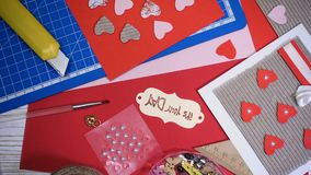 Girl making scrap Valentine greeting card. Hands of girl making scrap Valentine greeting card stock video footage