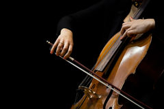Hands girl playing the cello Stock Images