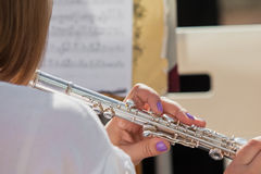 Hands girl playing a flute Stock Photo