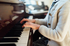 Hands girl playing piano Stock Photos