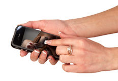 Hands of the girl who holds a mobile phone Stock Image