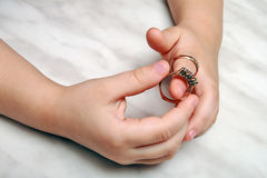 Hands of the girl who is trying on rings Stock Photography