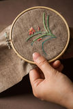 Embroidery. Hands of the girl working upon the embroidery Stock Photo