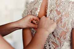 Hands of girls help to the bride Stock Images