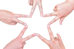 Hands of girls making star shape on white royalty free stock images