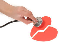 Hands girls with a stethoscope and two broken heart Royalty Free Stock Photos