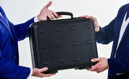 Hands give briefcase for exchange or offer bribe. Business transfer concept. Male hand hold briefcase. Handover of case. In hands of business partners. Handover royalty free stock image