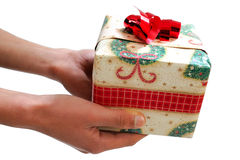 Hands that give. Hands that give in during the Christmas holidays Royalty Free Stock Photos