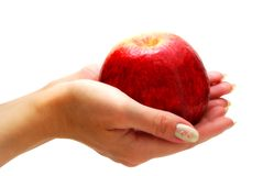 Hands Giving Apple. Female Hands Holding Apple Isolated on White Background Royalty Free Stock Photos