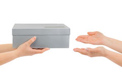 Hands giving box Stock Images