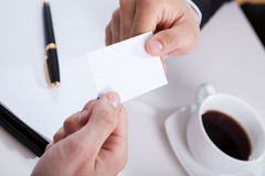 Hands giving business card Stock Photos