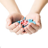 Hands giving capsules from pain Royalty Free Stock Photo