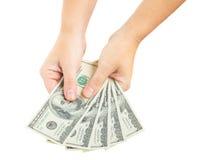 Hands giving dollars Stock Photos