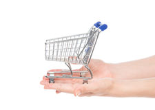 Hands giving empty shopping cart for sale. Isolated on a white background Stock Image