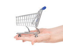Hands giving empty shopping cart for sale Stock Image