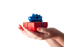 Hands giving a gift Stock Photo