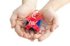 Hands giving a gift Royalty Free Stock Photos