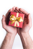 Hands giving gift. Concept hands giving gift on white background Royalty Free Stock Photography