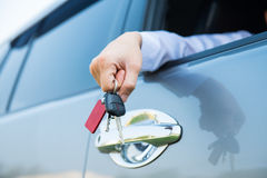 Hands giving a key for rental car Royalty Free Stock Image