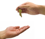 Hands giving keys Royalty Free Stock Photography