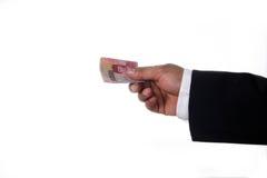 Hands giving money Stock Photo
