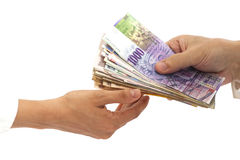 Hands giving money International currencies away Royalty Free Stock Image