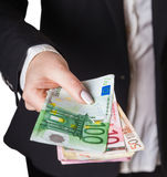 Hands giving money Stock Image