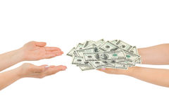 Hands giving money Stock Images