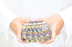 Hands giving pills Royalty Free Stock Photo