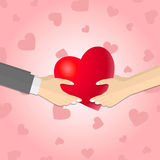 Hands giving a pink heart Royalty Free Stock Photography