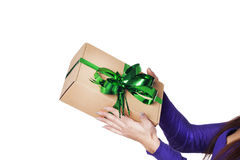 Hands giving a present over isolated background Royalty Free Stock Photo