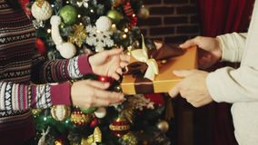 Hands giving and receiving christmas gift box stock footage