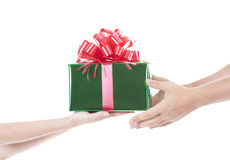 Hands giving and receiving a present Royalty Free Stock Photos