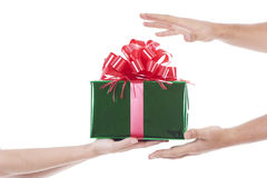 Hands giving and receiving a present Royalty Free Stock Image