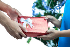 Hands giving and receiving a present Stock Image