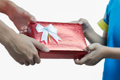 Hands giving and receiving a present Royalty Free Stock Photo